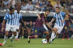 Cesc Fàbregas, rodeado de rivales.| Málaga 0-1 FC Barcelona. [25.08.13]