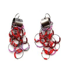 Oxidized silver with different colored glass beads2 1/2 inches in length Karen Gilbert