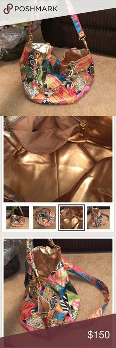 Braciano. Bag. It's. A beauty   Gold. Inside It's. A  braciano. Hobo bag    It. Has a zipper pocket inside  has a handle  or. A shoulder. Strap  ))))adjustable strap this. Is. A Brand New bag Braciano Bags Hobos