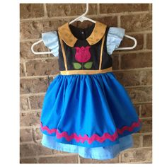 LOVE THIS!!!!!  Princess Anna dress with tulip embroidery rick by ThePrettyPiggy