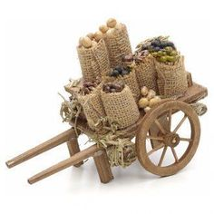 Carreta with dried fruits crib NaplesFairy cart from burlap, chopsticks, wood wheels n miniature foods Jute Crafts, Craft Stick Crafts, Diy And Crafts, Fairy Furniture, Miniature Furniture, Christmas Nativity Scene, Fairy Garden Accessories, Miniature Crafts, Fairy Houses