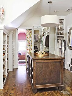 With twice the wardrobe and style needs, a shared space calls for a divide-and-conquer approach. See how this master closet makeover pairs good looks with savvy organization to create a peaceful space for two. Walk In Closet Design, Closet Designs, Closet Storage, Closet Organization, Hidden Storage, Attic Storage, Smart Storage, Storage Hacks, Kitchen Organization