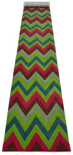 """A contemporary style hand tufted pure wool runner in light crimson red, sage green, teal green, dark lime green, dark lime green, deep line green and dark squirrel brown. It has a pile depth of 12-14mm. Created using the """"crazy horse"""" design."""