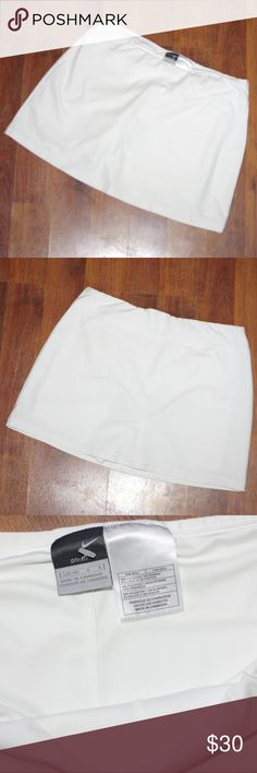 "NIKE DRI-Fit Skorts Large 14-16 Active Wear NWOT NIKE DRI-Fit Skorts Large 14-16 Active Wear NWOT By Nike Dri Fit Skorts Tag Size  L 14-16 White New without tags or packaging (unworn- tags came up missing so offering at discount on Poshmark) Waist Measured flat: 16"" Length: 15"" Super cute active wear for golf, tennis, athletics or yoga Nike Shorts Skorts"