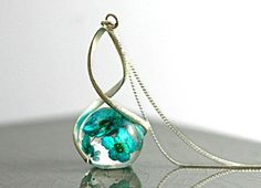 Sterling real flowers twisted necklace. Eco-friendly resin, turquoise flowers, sterling necklace. Jewelry for her.
