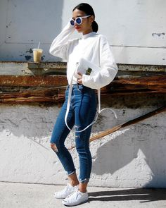 A White Turtleneck Sweater, Distressed Skinny Jeans, and White Sneakers