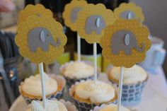 Cute elephant cupcake toppers at a Yellow and Gray Baby Shower!   See more party ideas at CatchMyParty.com!  #partyideas #babyshower