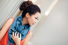 From blog entry: http://www.wendyslookbook.com/2012/04/color-story-orange-shift-teal-wrap/