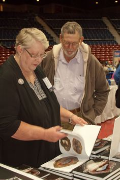 Abigail looking at Roland McIntosh's agate book.  He is the foremost authority on agates in Kentucky.  A real rock hound!   We are at the Ky Book Fair, the largest book fair in the US.