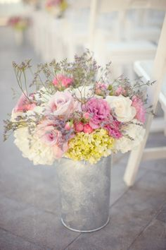 Pastel flowers in tin can.