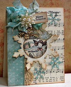 Lovely  Great use of sheet music and snowflake die.  Beautiful focal point in center of snowflake.