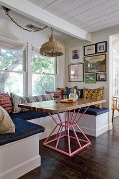 Eclectic banquette with gallery and pillows. I think I'd prefer a more vivid color on the table base, myself.