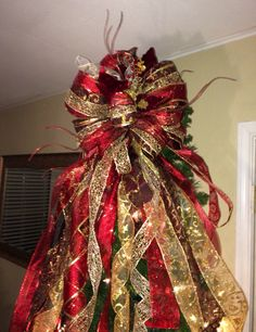 Six layered tree topper bow...custom and handmade by GeauxBowsByJaime on Etsy https://www.etsy.com/listing/255304747/six-layered-tree-topper-bowcustom-and