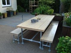 Outdoor picnic table made with Kee Klamp pipe fittings.
