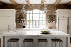 Love the brick, beams, and white