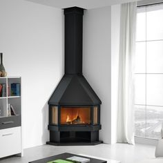 Looking for a corner fireplace? All of our corner fireplace range come expert advice and delivery to you. Corner Log Burner, Wood Burning Stove Corner, Modern Wood Burning Stoves, Corner Stove, Log Burning Stoves, Wood Stoves, Corner Fireplace Mantels, Stove Fireplace, Fireplace Design