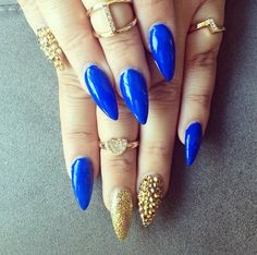 My fave :) royal blue w gold stiletto nails
