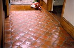 terra cotta floors in the master bedroom - I'd love to have the tiles laid like this, with a straight border.