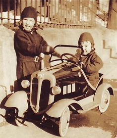 Cute boys with a fun pedal car.