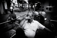 In chinatown, you can found many old people relaxing in the playground, quite many of them. I got this shot when he trying to sleep, and he doesn't know as well, sometime we play stalks in street photography.