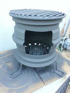 Repurposed car rim fireplace www whitedoverestoration com Rim Fire Pit, Fire Pit Grill, Fire Pit Backyard, Outdoor Stove, Outdoor Fire, Metal Projects, Welding Projects, Pliage Tole, Outdoor Kocher