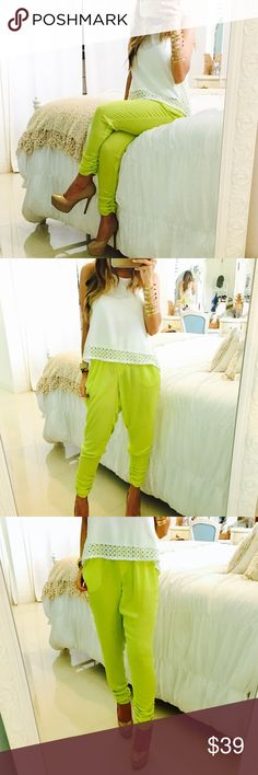 Lime Green Peg Trousers •Color: Lime Green •Style: Peg Trousers •Material: 100% Polyester  •Details: Elastic waist band. Bottom of the pants feature five decoration buttons along the side. •Measurement: 37 inches in length  •Gently used in great condition •No imperfections/flaws Pants Trousers