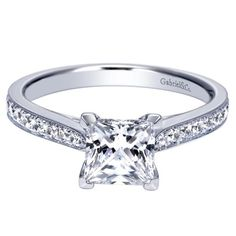 Princess cut engagement ring with channel set diamonds on the band. Gorgeous and simple!