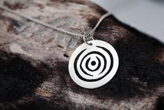Items similar to Circular swirly silver pendant on Etsy Australia, Etsy Shop, Studio, Trending Outfits, Pendant, Unique Jewelry, Handmade Gifts, Creative, Silver