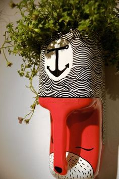 Repurpose and recycle old used plastic milk cartons into animal planters you can hang on the wall. Decorate with paint.