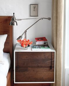 "The third-floor master bedroom is simple: a wall-mounted nightstand by BDDW, 1920s Parisian task lamps, and a king-size BDDW bed. ""We ended up getting this giant bed because our kids were coming into our bed every night,"" Pilar says."