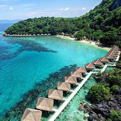 Welcome to paradise! El Nido Resorts Apulit in North Palawan, Philippines, features cottages on stilts set along a white-sand beach. Philippines Vacation, Philippines Beaches, Places To Travel, Travel Destinations, Places To Visit, Holiday Destinations, Exotic Beaches, Tropical Beaches, Voyager Loin