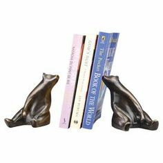 """Weathered brass bookend set with a sitting bear design.  Product: Set of 2 bookendsConstruction Material: BrassColor: PewterDimensions: 7"""" H x 4.5"""" W x 4.5"""" D"""