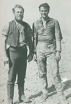 "John Wayne and pal Ward Bond in an uncredited appearance, on the set of ""THE BIG TRAIL"" 1930 / 23 years old"