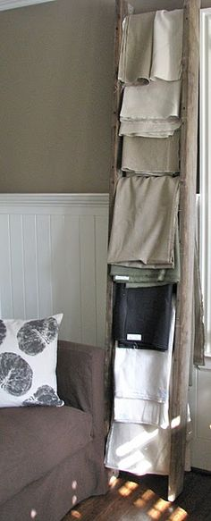 repurposed ladder into vertical fabric storage from melongings blog