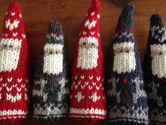 Inspired by magical scenes of Christmas in the snow in Scandinavia, these Santas are knit on straight needles in stockinette stitch in one piece and then seamed. Two patterns included - one for Santa bundled up in a heart pattern suit and the other for Santa in a cozy Nordic reindeer sweater. Final size is about 12.5 cm (5 in) high. Hang them from the tree or stand them up to decorate the house. Make adorable toys... very sweet seeing Santa's face peeking out of the stocking on Christmas…