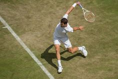 Grigor Dimitrov follows through with a backhand - Bob Martin/AELTC