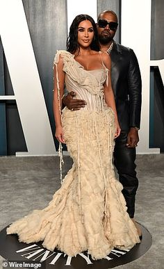 The happy couple: Kim and Kanye were their usual smouldering selves at the bash...