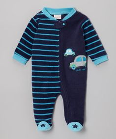 This footie zips up easily, with a snap tab at the neck. Made from fuzzy fleece, it's cozy on everything from tiny toes to ticklish tummies.