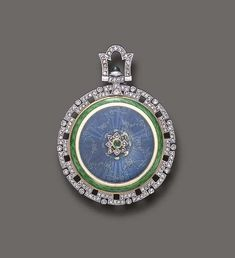 A BELLE EPOQUE ENAMEL, DIAMOND AND EMERALD PENDANT WATCH, BY TIFFANY & CO.
