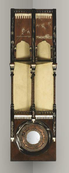 AN EBONISED WOOD AND PARCHMENT INLAID CORNER SHELF BY CARLO BUGATTI, CIRCA 1900