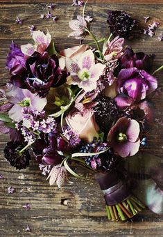 Dark and wonderful bouquet with hellebore, fritillary, rose and tulips
