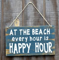 "Beach Decor, Beach Theme, Beach Wood Sign, ""At The Beach Every Hour Is Happy Hour"". $23.00, via Etsy."