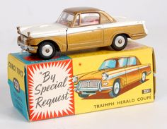Lot 1746 - Corgi Toys, 231 Triumph Herald Coupe, gold and white body with red interior, flat spun hubs, in the