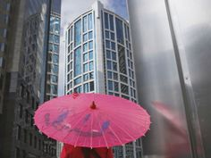China, Shanghai, Girl with Red Umbrella with Highrises in Pudong Area Photographic Print by Keren Su at Art.com