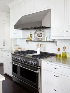 Like the metal shelf above the stove - should do that to get oil, salt, etc off counter space.  Make sure it's deep enough...