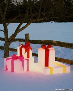 Outdoor lighted christmas gift boxes front porch christmas decor good glowing gift boxes lit from within these presents suggest magical snow sculptures aloadofball Gallery