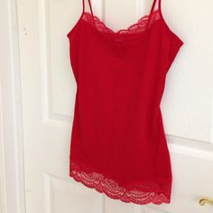 Express Red Camisole with Lace Wow Factor! Gorgeous red top with lace trim at top and bottom hem. Can be used as a undergarment, top under another shirt or alone. 95 percent cotton/5 percent spandex Express Tops Camisoles