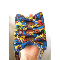 Calling all Superman Fans!!These bow ties are made with 100% cotton material, Pretied, lined to add crispness and strength, and available in sizes infant through adult. Also made with a hook, eye, and slider to further adjust neck size.