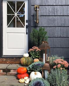 House seven design has such a great front porch fall decor with a mix of colorful pumpkins but also added more natural plant elements and greenery. The cool Atwater pendant adds a cool vintage vibe.  #fall #exterior #sconce #outdoordecor #autumn #pumpkins #lighting #interiordesign #rustic #rusticglam #fall #falldecor #falltones #frontporchfalldecor #fallporchfalldecor #frontporchfalldecorfarmhouse #frontporchfalldecorideas