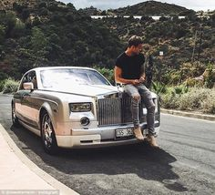 Not sure the Roller and ripped jeans compliment each other! A stylish summer; Marcus Wetterheim is just one of many teenagers to have appeared on the Rich Kids of Instagram blog. Above, he takes a break during a road trip in a luxury car in La Quinta Hills, Marbella, Spain